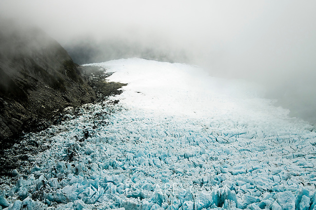 Crevassed up middle parts of the Fox Glacier under the rain clouds - Westland National Park, West Coast, New Zealand
