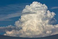 A huge thunderhead cloud forms in the late afternoon in White Sands National Park, New Mexico.