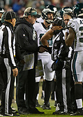 Philadelphia Eagles head coach Doug Pederson, left, shakes hands with side judge James Coleman (95) during a break in the game against the Washington Redskins at FedEx Field in Landover, Maryland on December 30, 2018.  The Eagles won the game 24 - 0.<br /> Credit: Ron Sachs / CNP
