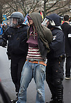 A counter-demonstrator is arrested during a demonstration by the Alternative für Deutschland (AfD) political party in Berlin. Around 5000 supporters of the AfD took part in the march and rally calling on German Chancellor Angela Merkel to halt the influx of refugees into the country. Around one million refugees from the Middle East and north Africa arrived in Germany during 2015, 50,000 of whom came to Berlin.