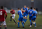 The visiting team defending a free-kick during the second-half as Gala Fairydean Rovers (in red) host Gretna 2008 in a Scottish Lowland League match at Netherdale, Galashiels. The home club were established in 2013 through a merger of Gala Fairydean, one of Scotland's most successful non-League clubs, and local amateur club Gala Rovers. The visitors were a 'phoenix' club set up in the wake of the collapse of the original club, which had competed for a short time in the 2000s before going bankrupt. The home aside won this encounter 4-1 watched by a crowd of 120 at a stadium which features one of the country's most notable stands, a listed building constructed in 1964 but at the time of this fixture closed to spectators on safety grounds.