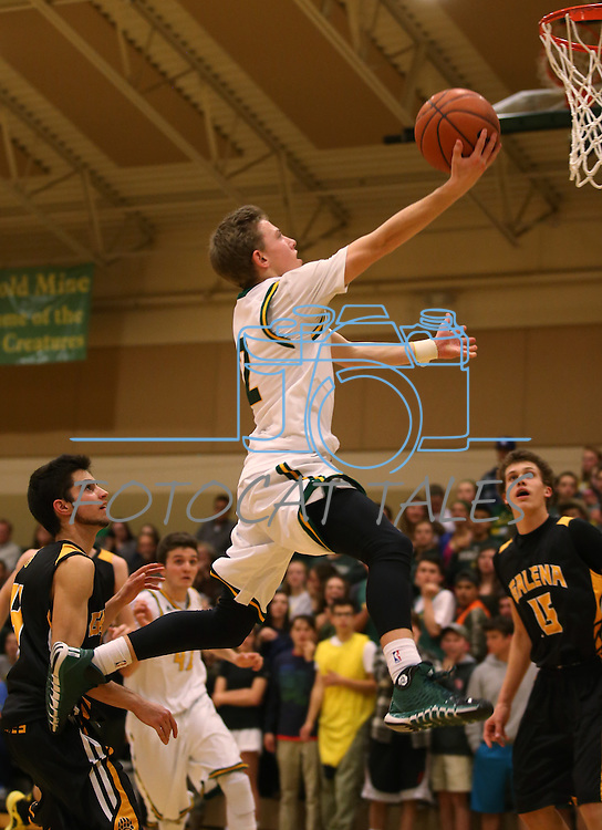 Collin Bernard makes a shot against Galena at Manogue High School in Reno, Nev., on Tuesday, Feb. 11, 2014. Manogue won 66-59.<br /> Photo by Cathleen Allison