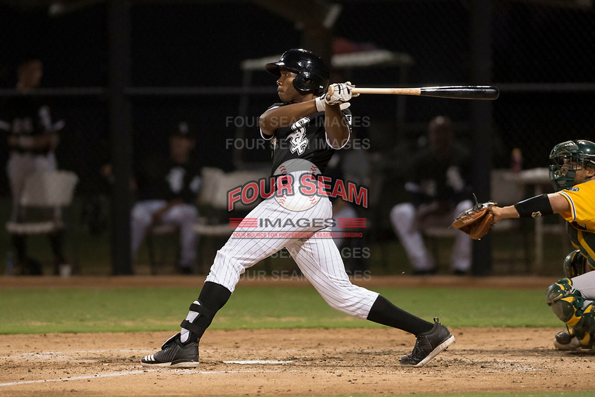 AZL White Sox third baseman Bryce Bush (61) follows through on his swing during an Arizona League game against the AZL Athletics at Camelback Ranch on July 15, 2018 in Glendale, Arizona. The AZL White Sox defeated the AZL Athletics 2-1. (Zachary Lucy/Four Seam Images)