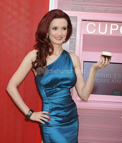 LAS VEGAS, NV - March 21 : Holly Madison is first person to use the Cupcake ATM at the grand opening of Sprinkles Cupcakes Las Vegas at The Linq in Las Vegas, NV on March 21, 2014. Credit: RTNRDEK/MediaPunch