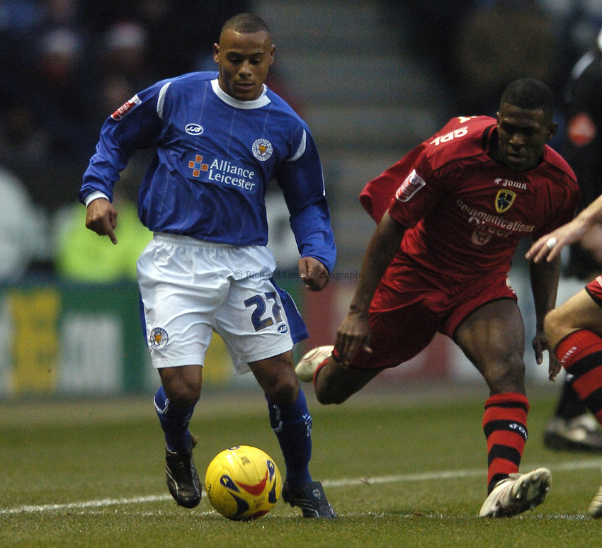 Photo: Jonathan Butler..Leicester City v Cardiff City. Coca Cola Championship. 23/12/2006..Levi Porter of Leicester City is challenged by Kerrea Gilbert of Cardiff.