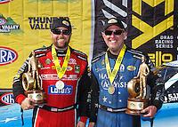 Jun 19, 2016; Bristol, TN, USA; NHRA top fuel driver Shawn Langdon (left) and teammate, funny car driver Tommy Johnson Jr celebrate after winning the Thunder Valley Nationals at Bristol Dragway. Mandatory Credit: Mark J. Rebilas-USA TODAY Sports