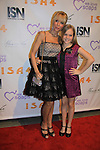 """Signy Coleman's daughter Isabella poses with The Young and The Restless' Signy Coleman """"Hope Wilson""""and Guiding Light """"Annie Dutton"""" and Santa Barbara is nominated as best actress - drama in River Rouge and poand is a presenter as We Love Soaps and The Indie Series Network present the 4th Annual Indie Soap Awards - ISAs on February 19, 2013 from New World Stages, New York City, New York -  (Photo by Sue Coflin/Max Photos)"""