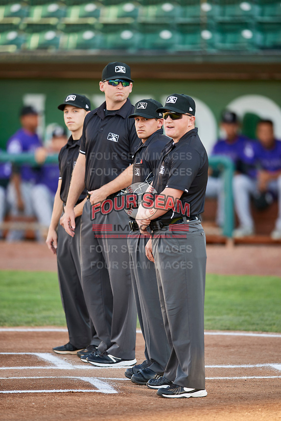 Umpires John Perez, Matt Herrera, Pete Talkington and Zachary Robbins before a game between the Grand Junction Rockies and Ogden Raptors at Lindquist Field on September 7, 2018 in Ogden, Utah. The Rockies defeated the Raptors 8-5. (Stephen Smith/Four Seam Images)