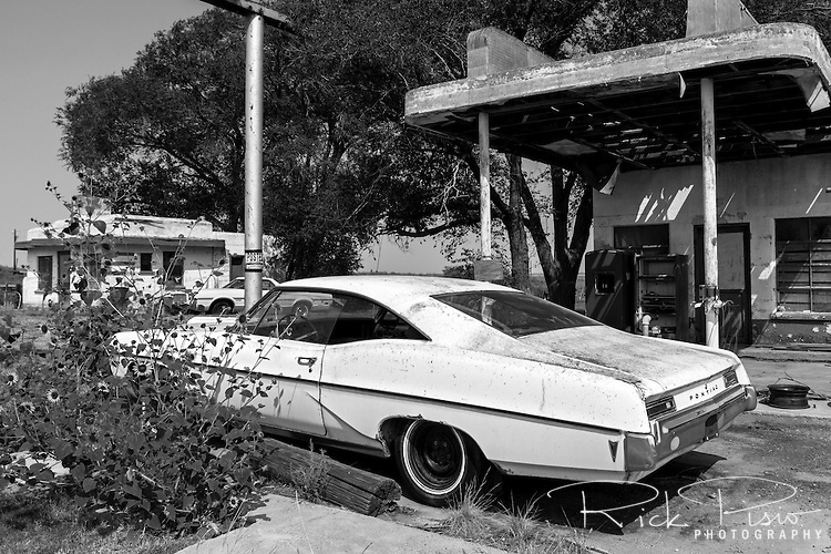 A 1968 Pontiac Bonneville waits for a fill up at the Glenrio Texaco station next to the Little Juarez Café on the Texas side of town along Route 66. Glenrio thrived through the 40's, 50's, and 60's until the Interstate bypassed the town in 1975.