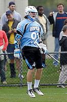 Johns Hopkins (92) celebrates a goal during the game against the Virginia Cavaliers in Charlottesville, VA. Johns Hopkins defeated Virginia 11-10 in overtime. Photo/Andrew Shurtleff