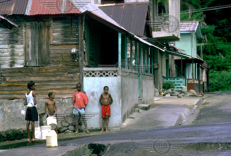 Children collect water from a standpipe.