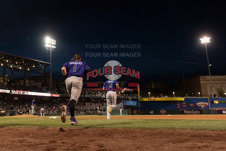Albuquerque Isotopes second baseman Brendan Rodgers (1) jogs onto the field during a game against the El Paso Chihuahuas at Southwest University Park on May 10, 2019 in El Paso, Texas. Albuquerque defeated El Paso 2-1. (Zachary Lucy/Four Seam Images)