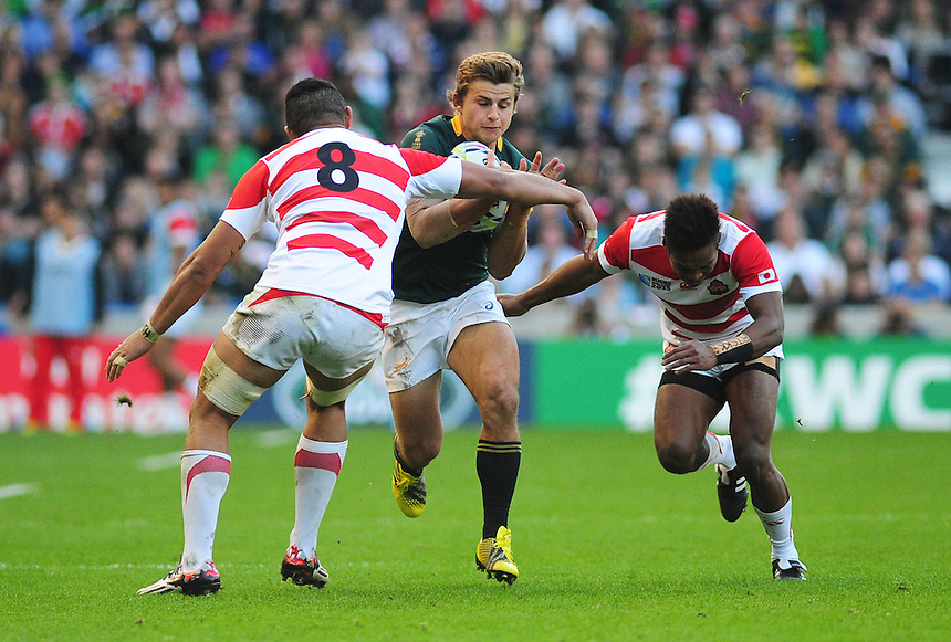 South Africa's Patrick Lambie is tackled by Japan's Hendrik Tui<br /> <br /> Photographer Kevin Barnes/CameraSport<br /> <br /> Rugby Union - 2015 Rugby World Cup - Japan v South Africa - Saturday 19th September 2015 - The American Express Community Stadium - Falmer - Brighton<br /> <br /> &copy; CameraSport - 43 Linden Ave. Countesthorpe. Leicester. England. LE8 5PG - Tel: +44 (0) 116 277 4147 - admin@camerasport.com - www.camerasport.com