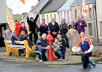 Brosna GAA Club chairman Jimmy Keane with supporters front from left, Geoffrey Byrne, Dan Shine, Michael Collins, John Murphy and players, Michael Murphy and Tom and Darragh McGoldrick. At back, Garett Barry, Kieran Flanagan, Mikey O'Connor, Michael Wlash, Mike Borsnan, Patrick Browne and Liam Curtin pictured in Brosna Village in County Kerry on Friday.<br /> Picture by Don MacMonagle<br /> <br /> xxjob