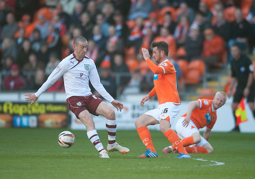 Burnley's David Jones and Blackpool's Barry Ferguson<br /> <br /> Photo by Stephen White/CameraSport<br /> <br /> Football - The Football League Sky Bet Championship - Blackpool v Burnley - Friday 18th April 2014 - Bloomfield Road - Blackpool<br /> <br /> &copy; CameraSport - 43 Linden Ave. Countesthorpe. Leicester. England. LE8 5PG - Tel: +44 (0) 116 277 4147 - admin@camerasport.com - www.camerasport.com