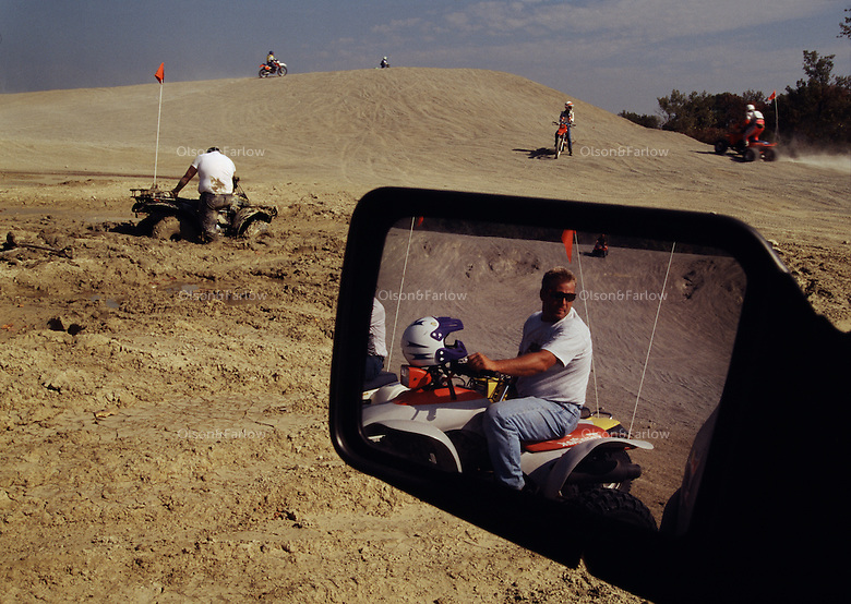 Off-road enthusiasts enjoy riding on old mine tailings at St. Joe State Park. This park is on the list of potential superfund cleanup sites.  It is the largest and highest use park in Missouri.  Workers are tested for heavy metals every 3 months. Once an ancient sea, its uplifted floor untouched by scouring glaciers that stopped to the north.  Eons of erosion carved deep valleys into the Ozarks crusty limestone plateau, transforming its flat surface into the unlikely role of hills.  They march nearly level into the distance, and peak at 2,600 feet in Arkansas's Boston Mountains...  Ozarks region in Missouri and Arkansas by Randy Olson for National Geographic Magazine.
