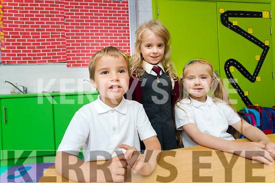 Daniel Jahimaa, Kila Mazurek, Amelia Gaxha, enjoying their first day of school at Moyderwell Primary School, Tralee, on Wednesday morning last.