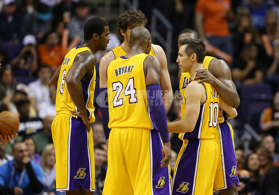 Jan. 30, 2013; Phoenix, AZ, USA: Los Angeles Lakers guard Steve Nash (10) and Kobe Bryant (24) in the huddle with teammates in the second half against the Phoenix Suns at the US Airways Center. The Suns defeated the Lakers 92-86.  Mandatory Credit: Mark J. Rebilas-