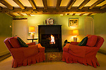 Two large chairs and fireplace in the sitting room of Obriss Farm. Obriss Farm is a building near Westerham, Kent,  belonging to the Landmark Trust, a United Kingdom building preservation charity that rescues historic buildings at risk and gives them a new life as places to stay in and experience.