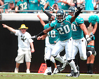 Jacksonville Jaguars special teams players celebrate the recovery of an Arizona Cardinals fumble on a punt at Jacksonville Municipal Stadium in Jacksonville, Fl. (The Florida Times-Union, Rick Wilson)