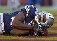 05 November 2006:  Dallas Cowboys WR Terrell Owens (81) uses the ball as a pillow, curls up,  and pretends to go to sleep in the end zone after a TD catch.  News during the week leading up to the game was of Owens sleeping in team meetings.  The Washington Redskins defeated the Dallas Cowboys 22-19 at FedEx Field in Landover, MD.<br />