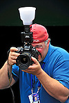 24 May 2009: Photographer Mark Goldman works in the Washington Nationals dugout prior to a game against the Baltimore Orioles at Nationals Park in Washington, DC. The Nationals rallied to defeat the Orioles 8-5 and salvage one win of their interleague series. Mandatory Credit: Ed Wolfstein Photo