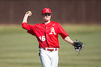 Matt McGarry (16) of the Belmont Abbey Crusaders warms up in the outfield prior to the game against the Shippensburg Raiders at Abbey Yard on February 8, 2015 in Belmont, North Carolina.  The Raiders defeated the Crusaders 14-0.  (Brian Westerholt/Four Seam Images)