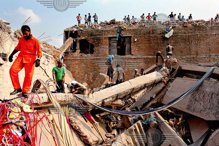Rescue teams search for survivors in the ruins of the collapsed Rana Plaza complex in Savar.The 8 storey Rana Plaza complex, which housed a number of garment factories employing over 3,000 workers, collapsed on 24 April 2013. By 29 April, at least 380 were known to have died while hundreds remained missing. Workers who were worried about going to work in the building when they noticed cracks in the walls were told not to worry by the building's owner, Mohammed Sohel Rana, who is a member of the ruling Awami League's youth front. He fled his home and tried to escape to neighbouring India after the building collapsed but was caught by police and brought back to Dhaka. Some of the factories working in the Rana Plaza building produce cheap clothes for various European retailers including Primark in the UK and Mango, a Spanish label. The final death toll was 1,127. /Felix Features