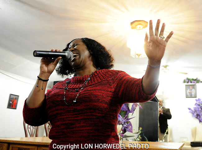 "Mildred Daniels, 54, sings her praises to the Lord during her Wednesday night church service. Singing, and praise, are big parts of her life in Sheldon Twp. a life that she says was ""saved"" by the HEAL program.  A year ago, Daniels blood pressure was 169/118, a change in her diet to cut down her portions and eliminate salt, helped her shed 20 pounds and drop her blood pressure to 116/78."
