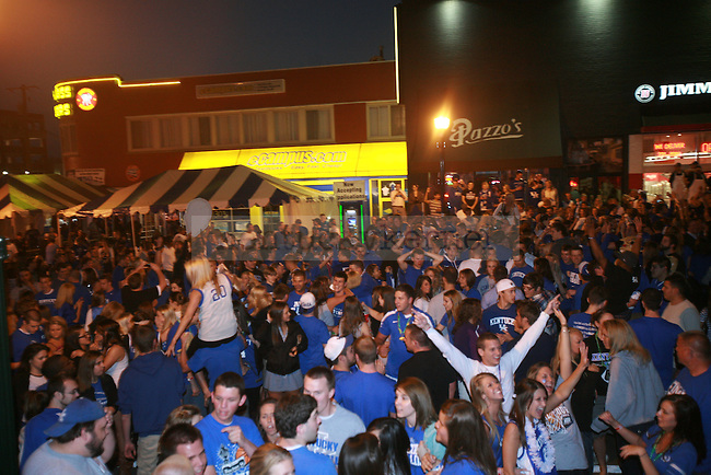 Fans celebrate after the UK-Louisville Final Four game on March 31, 2012, in Lexington, Ky. The Cats won 69-61. Photo by Quianna Lige | StaffFans celebrate after the UK-Louisville Final Four game on March 31, 2012, in Lexington, Ky. The Cats won 69-61. Photo by Quianna Lige | Staff