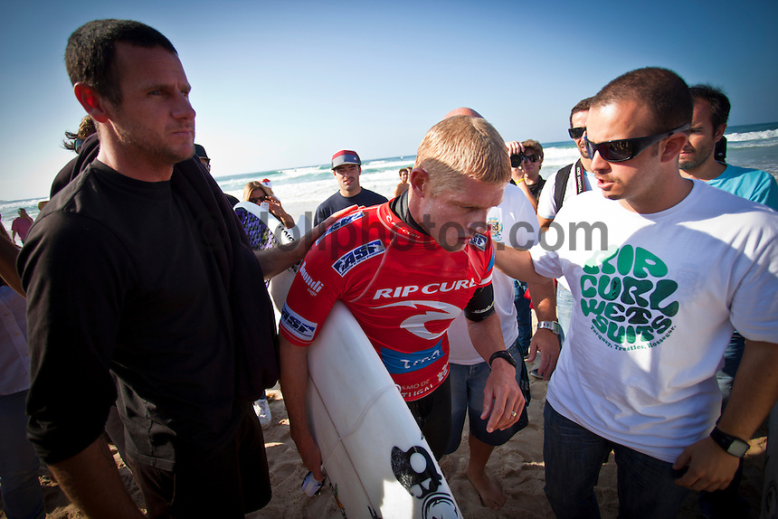 Mick Fanning (AUS) with Red Bull Coach Andy King (AUS) waiting for Mick's final score to be read out. It wasn't enough and he bowed out of the 2010 World Title race. BELGAS, Peniche/Portugal (Tuesday, October 12, 2010) - The world's best surfers showcased their unparalleled versatility today, trading the barrels of Supertubos for punchy two-to-three (1 metre) peaks at Belgas for Round 3 of the Rip Curl Pro Portugal.. Event No. 8 of 10 on the 2010 ASP World Tour, today's Rip Curl Pro Portugal bore witness to major developments in the ASP World Title Race, with two major contenders bowing out in Round 3 of competition.. Travis Logie (ZAF), 31, current ASP World Tour No. 34, caused the upset of the event this afternoon, eliminating reigning ASP World Champion and current ASP World No. 3, Mick Fanning (AUS), 29, from competition with a frenzied backhand assault on the Belgas righthanders..After dispatching of current ASP World No. 5, Dane Reynolds (USA), 25, in Round 2 yesterday, Logie's confidence is running high with intentions of carrying him to a solid result in Portugal towards his requalification campaign..Matt Wilkinson (AUS), 22, 2010 ASP Dream Tour rookie and current ASP World No. 27, caused another monster upset in the opening heat of the afternoon, eliminating current ASP World No. 4, Taj Burrow (AUS), 32, with an inspired display of progressive surfing..Photo: joliphotos.com