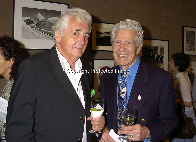 Harry Benson and John Dominis..at a Photography Auction to Benefit Equality Now on June 20, 2005 at Christies. ..Photo By Robin Platzer, Twin Images