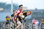 Rathmore's Aidan O'Mahony puts Dr Crokes Johnny Buckley under pressure during their Senior Club Championship semi final clash in Fitzgerald Stadium on Saturday