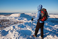 Female hiker on summit of Pen Y Fan in winter, Brecon Beacons national park, Wales