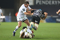 Justin Tipuric of Ospreys is tackled by Sitaleki Timani of Clermont during the Champions Cup Round 1 match between Ospreys and Clermont at The Liberty Stadium, Swansea, Wales, UK. Sunday 15 October 2017