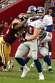Landover, MD - December 8, 2002 -- Washington Redskin linebacker Kevin Mitchell (55) attempts to block Giant tight end Jeremy Shockey (80) during first quarter action.  The Giants won the game 27 - 21.<br /> Credit: Ron Sachs / CNP<br /> [NOTE: No New York Metro or other Newspapers within a 75 mile radius of New York City]