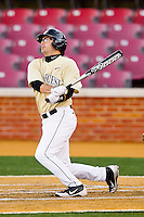 Pat Blair #11 of the Wake Forest Demon Deacons connects for a double in the bottom of the first inning against the Georgetown Hoyas at Wake Forest Baseball Park on February 26, 2012 in Winston-Salem, North Carolina.  (Brian Westerholt / Four Seam Images)