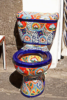 Talavera tiled toilet for sale at El Parian handicrats market in the city of Puebla, Mexico in the city of Puebla, Mexico. The historical center of Puebla is a UNESCO World Heritage Site..