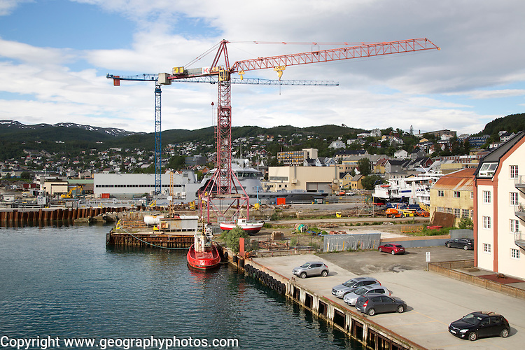 Cranes at construction site of in the port area of Tromso, Norway
