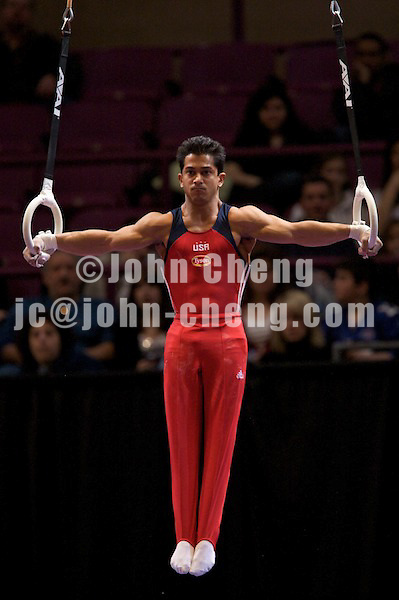 3/1/08 - Photo by John Cheng -  Raj Bhavsar of the United States performs on steel rings at the Tyson American Cup in Madison Square GardenPhoto by John Cheng - Tyson American Cup 2008 in Madison Square Garden, New York.Bhavsar