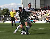 Alan Maybury beats Steven Thompson in the St Mirren v Hibernian Clydesdale Bank Scottish Premier League match played at St Mirren Park, Paisley on 18.8.12.