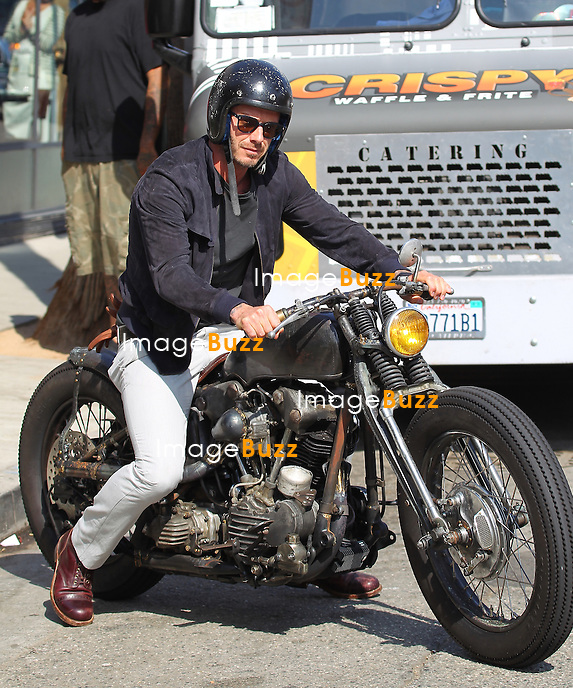 David Beckham enjoys riding his custom-made vintage Harley Davidson, in Venice Beach, California..Los Angeles, August 3, 2012.
