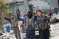 Photographer: Rick Findler/Borderline News..20.01.13 Soldiers belonging to the Free Syrian Army pose for a picture on the heart of Aleppo, Northern Syria. The city has been victim to irrepribable damage from the heavy fighting against the Free Syrian Army and President Assad's regime army.