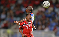 Couva, Trinidad & Tobago - Tuesday Oct. 10, 2017: Leston Paul, Darlington Nagbe during a 2018 FIFA World Cup Qualifier between the men's national teams of the United States (USA) and Trinidad & Tobago (TRI) at Ato Boldon Stadium.