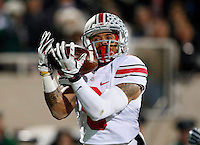 Ohio State Buckeyes wide receiver Devin Smith (9) catches a touchdown pass during the second quarter of the NCAA football game against the Michigan State Spartans at Spartan Stadium in East Lansing, Michigan on Nov. 8, 2014. (Adam Cairns / The Columbus Dispatch)