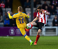Lincoln City's Luke Waterfall vies for possession with Chester's Elliott Durrell<br /> <br /> Photographer Chris Vaughan/CameraSport<br /> <br /> Vanarama National League - Lincoln City v Chester - Tuesday 11th April 2017 - Sincil Bank - Lincoln<br /> <br /> World Copyright &copy; 2017 CameraSport. All rights reserved. 43 Linden Ave. Countesthorpe. Leicester. England. LE8 5PG - Tel: +44 (0) 116 277 4147 - admin@camerasport.com - www.camerasport.com