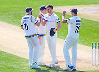Picture by Alex Whitehead/SWpix.com - 21/04/2018 - Cricket - Specsavers County Championship Div One - Yorkshire v Nottinghamshire, Day 2 - Emerald Headingley Stadium, Leeds, England - Yorkshire's Ben Coad is congratulated on the wicket of Notts' Harry Gurney.