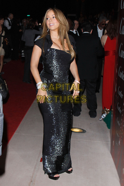 MARIAH CAREY CANNON.The 21st Annual Palm Springs International Film Festival held at The Civic Center in Palm Springs, California, USA. .January 5th, 2010.full length black maxi dress sparkly beads beaded silver bracelets cropped jacket.CAP/RKE/DVS.©DVS/RockinExposures/Capital Pictures.