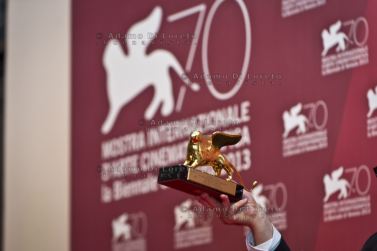Director Gianfranco Rosi poses with the Golden Lion he awarned for the Best Film for his movie 'Sacro Gra' as he attends the Award Winners Photocall during the 70th Venice International Film Festival at Palazzo del Casino on September 7, 2013 . (Photo by Adamo Di Loreto/BuenaVista*photo)