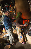 Nepal Sherpa woman and son make tea and dumplings in their tea house in Namche Bazarre remote Mt Everest 76 77